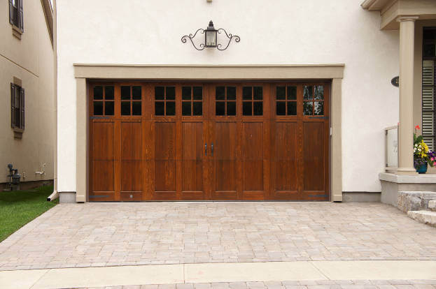 2016 garage door trends garage remodeling costs for Fake wood garage doors