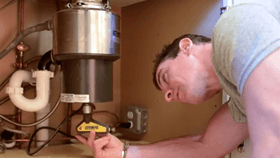 Video: How To Fix A Garbage Disposal