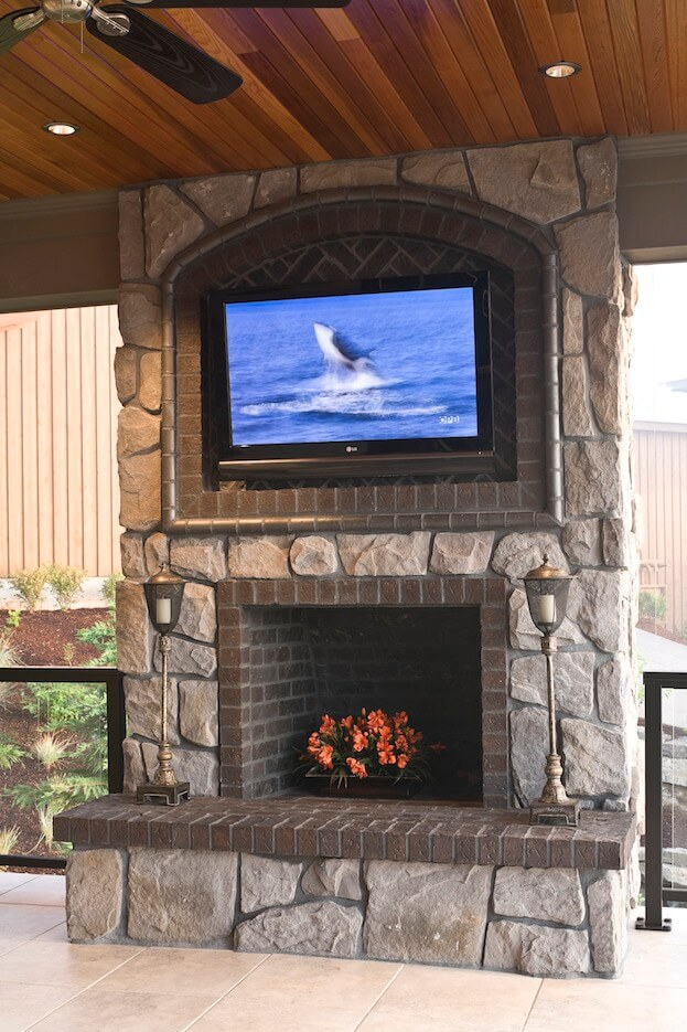 Mounting a TV over a fireplace can get complicated
