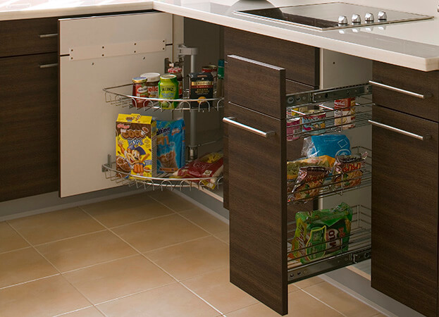To keep your kitchen storage organized and easy to access, try adding a pullout shelf to your cabinets.